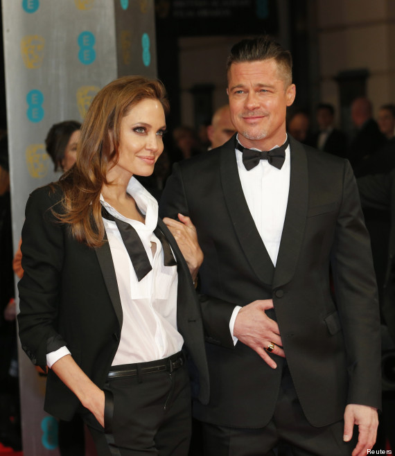 Actors Brad Pitt (R) and Angelina Jolie arrive at the British Academy of Film and Arts (BAFTA) awards ceremony at the Royal Opera House in London February 16, 2014. REUTERS/Suzanne Plunkett (BRITAIN - Tags: ENTERTAINMENT) - RTX18YMD