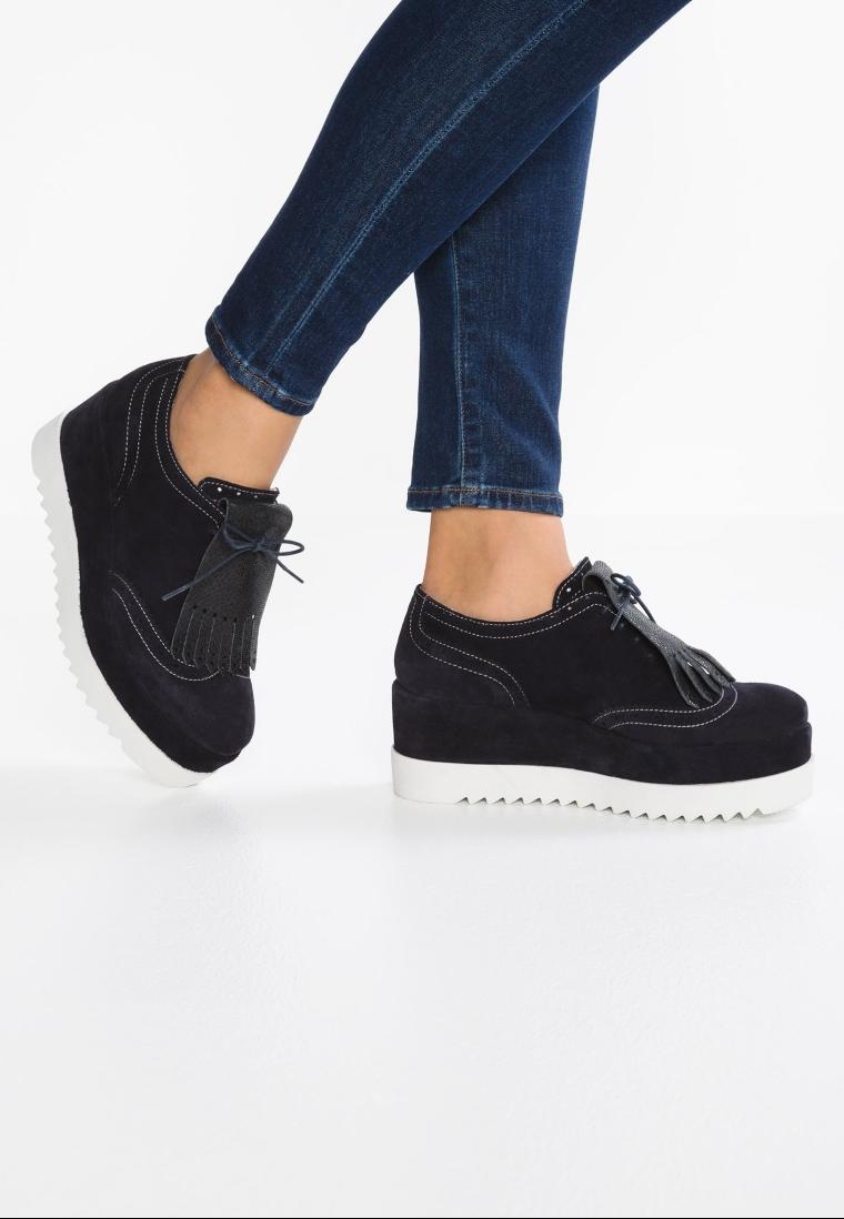 derbies noirs façon creepers look sportwear